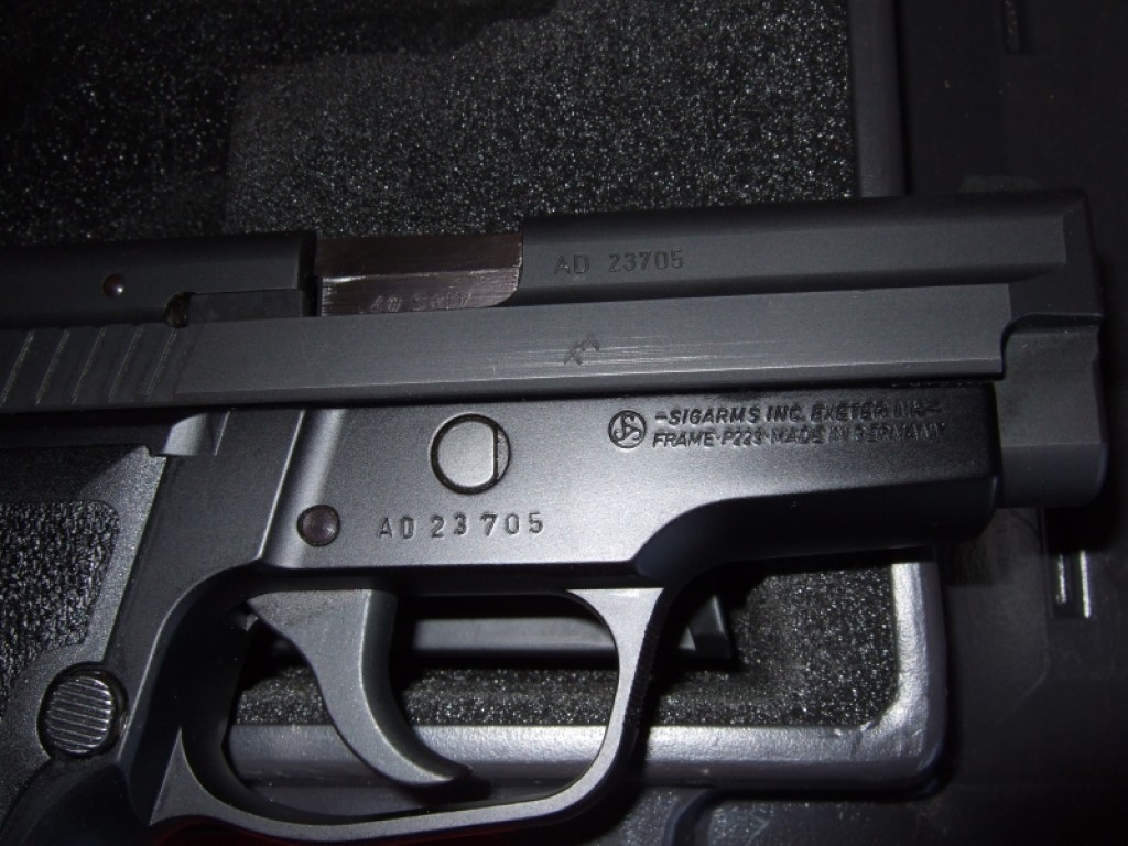 US-assembled SIG P229 with US slide, US barrel, and German frame.